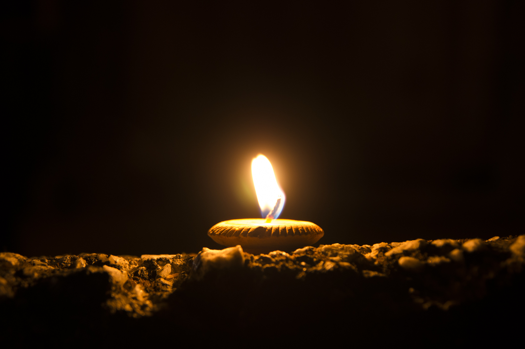 Small candle in the dark