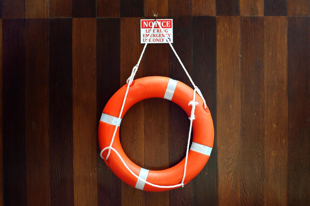 Lifebuoy hang on a wooden wall