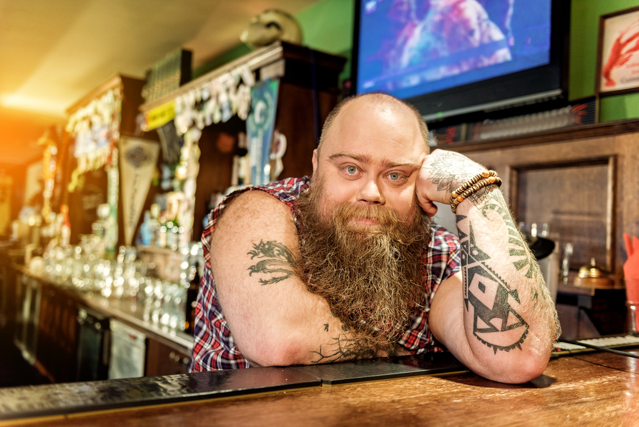 Serene fat bartender reclining on worksurface